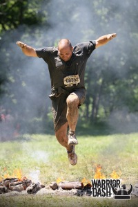 Me jumping over the fire at Warrior Dash Illinois 2014