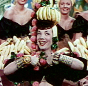 Four drinks! Public domain image via http://commons.wikimedia.org/wiki/File:Carmen_Miranda_in_The_Gang%27s_All_Here_trailer_cropped.jpg