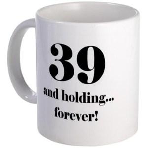 39 and holding mug