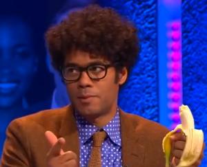 Richard Ayoade eating a banana.