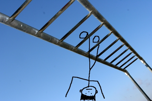 Stick figure doing monkey bars upside down