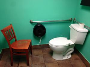Toilet with adjacent chair